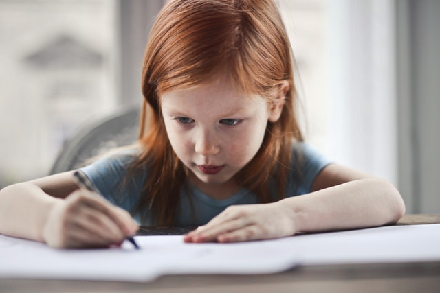girl-writing-on-paper-1843358