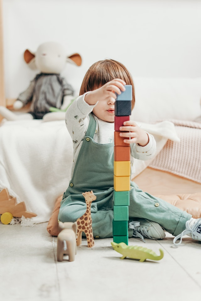 child-in-white-long-sleeve-top-and-dungaree-trousers-playing-3661356